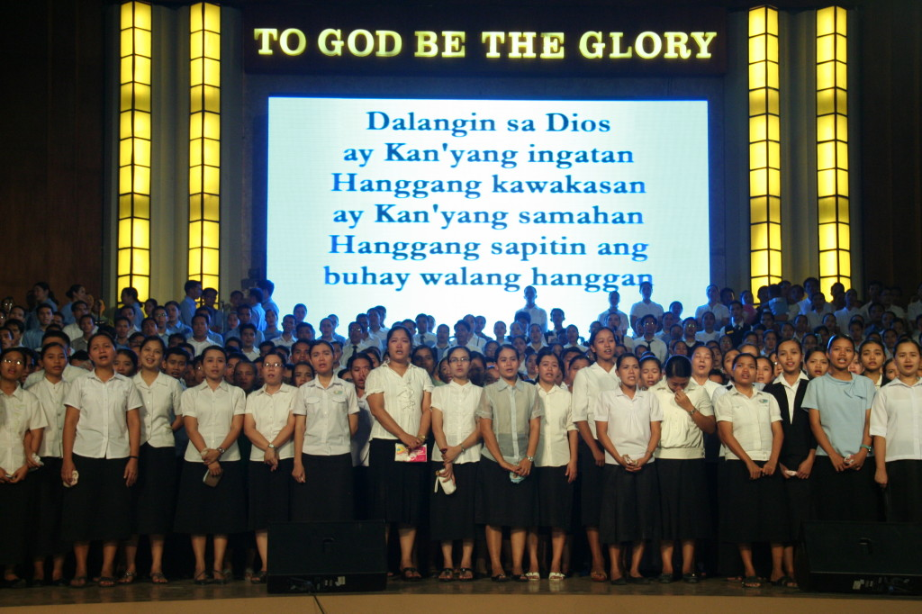 To express their gratitude, Members of the Church of God offer songs of praise on stage as part of their Thanksgiving.