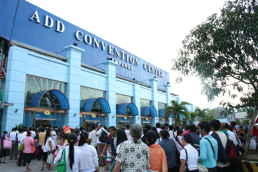 Members of the Church of God and visitors line up to get inside the Ang Dating Daan Convention Center in Apalit, Pampanga to attend a three-day Thanksgiving to God.