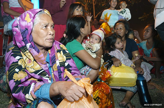 Two families receive gifts from MCGI on December 31st 2012.