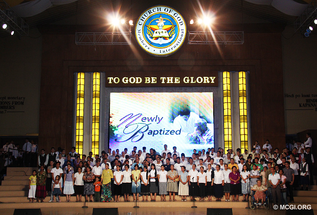 Some of the newly baptized Members of the Church of God from the Mass Baptism of January 2013 singing an offering to God at the ADD Convention Center stage.