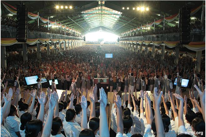 From the stage to the other end of the Convention Center, all raised their hands during a Thanksgiving song number in MCGI's three-day International Thanksgiving.