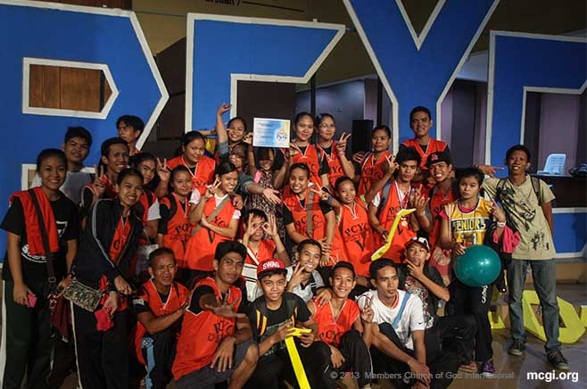 After the annual Pampanga and Central Youth Convention ended, some participants take a pose at the ADD Convention Center stage in Apalit, Pampanga.