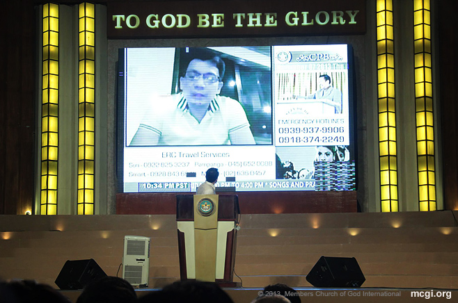 Bro. Daniel Razon looks at the playback of his advice to members of the Church of God International in Visayas to force evacuate before Typhoon Haiyan hit the Philippine Island in November of 2013.