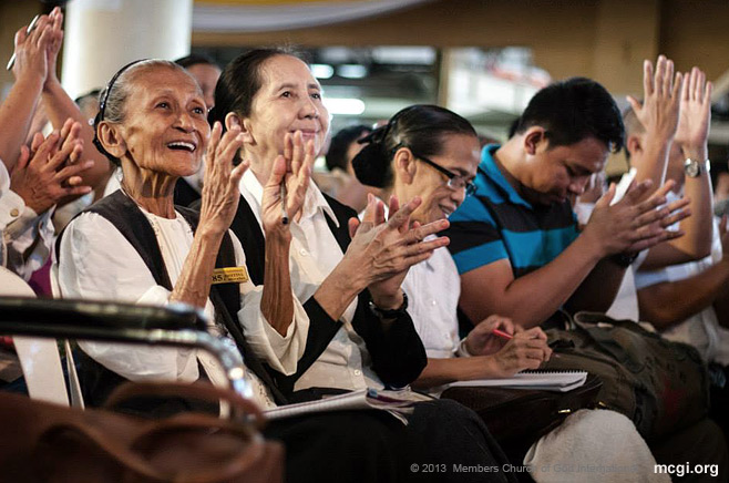 During a Thanksgiving of he Body in 2013, brethren clap and cheer during a biblical topic served by MCGI Leaders Bro. Eli Soriano and Bro. Daniel Razon.