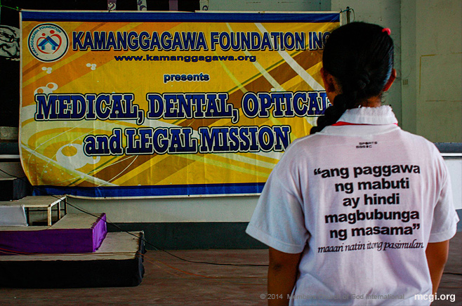 "An MCGI member at the medical mission on February 24, 2014 in Quezon City wearing a Just One Day shirt that says in English, ""Doing good will not bring forth evil."""