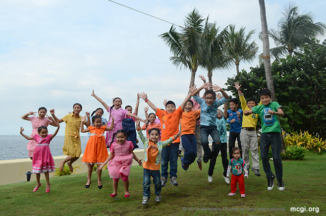 After taping the kids of the KNC Show take a jump shot by the Manila bay.  (Photo courtesy of Joy Reyes, PVI)
