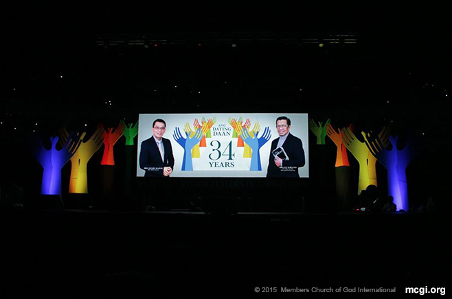 Wide LED screens show  The Old Path's 34th Anniversary logo bearing the photos of MCGI's Overall Servants Bro. Eli Soriano (right) and Bro. Daniel Razon (left). (Photo courtesy of PVI)