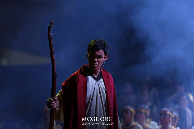 """Moses"" as presented by the National Capital Region stands before the crowd during the penultimate number of their musical play."