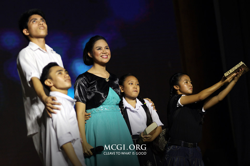 "Sis Crystal Cruz smiles as she finishes interpreting the Song of the Year-End titled ""Since My Younger Days"" composed by Bro. Nonie Ramos and Bro. Pabemazar Atienza of New Jersey, USA. (MCGI-Photoville/ Christian Diversion)"