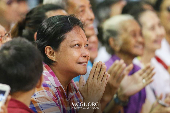 Filipina actress and superstar, Nora Aunor, smiles and claps as she listens intently to the serving of the biblical topic during the 3rd day of the Thanksgiving of God's People event.